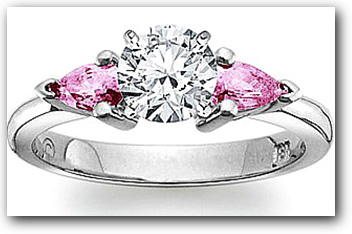 Three stone diamond and pink sapphire engagement ring