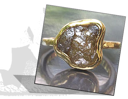 Rough diamond engagement ring with bezel setting