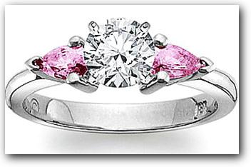 Three stone diamond and pink sapphire engagement ring